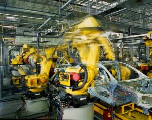 yellow robots welding cars in a production line, (c) Fotolia.com, RainerPlendl, 23546743